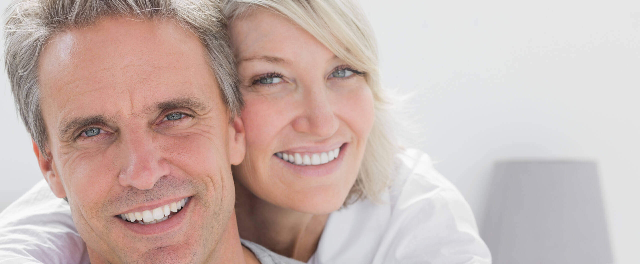 an older couple with veneers smiling