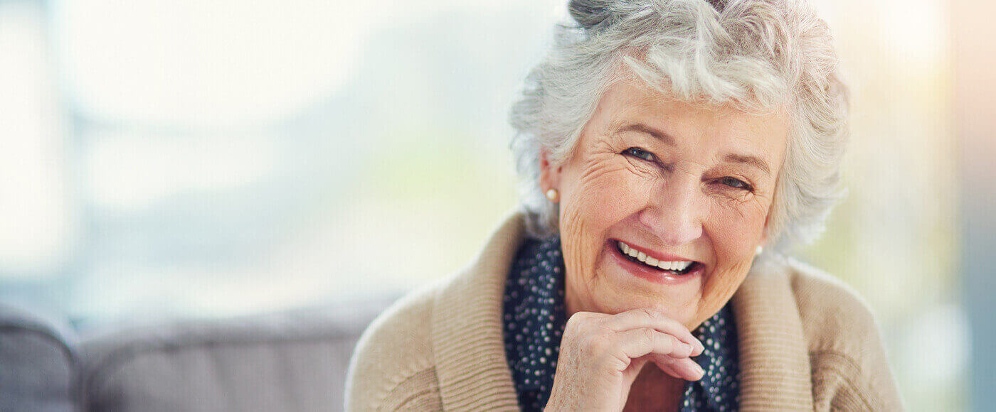 Beautiful elderly woman with dentures smiling